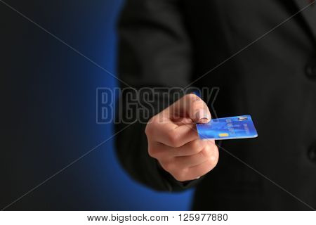 Businesswoman giving a credit card.