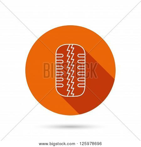 Tire tread icon. Car wheel sign. Round orange web button with shadow.