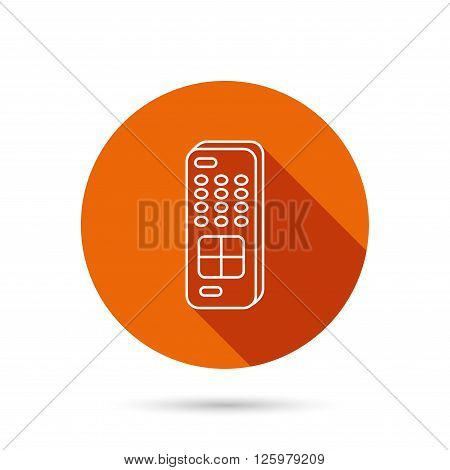 Remote control icon. TV switching channels sign. Round orange web button with shadow.