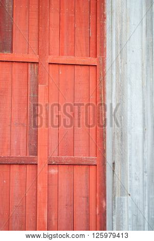 Weathered Red Wooden Door on Wooden Outbuilding