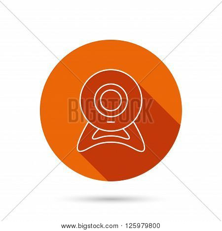 Web cam icon. Video camera sign. Online communication symbol. Round orange web button with shadow.