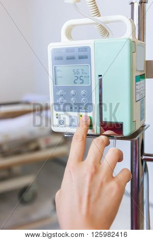 Nurse's Hands Regulation Infusion Pump Intravenous Iv Drip.