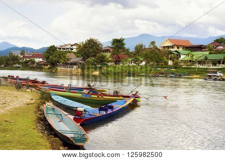 Boats by the Song River in Vang Vieng, Laos.