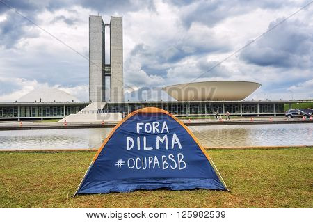 Brasilia, Brazil - November 20, 2015: Tent of protester in front of the Brazilian National Congress (Congresso Nacional) in Brasilia, capital of Brazil.
