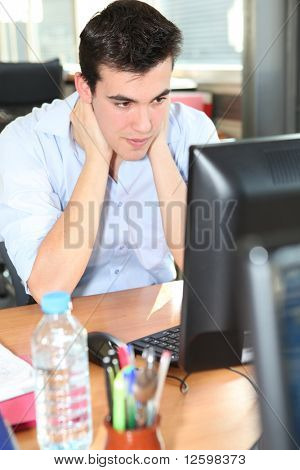 Young man tense at work
