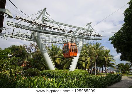 NHA TRANG, VIETNAM - JANUARY 01, 2016: The cabin of a ropeway goes with the tourists in the resort Viniperl