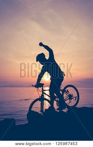 Healthy Lifestyle. Silhouette Of Bicyclist Riding The Bike At Seaside. Outdoors. Vintage.