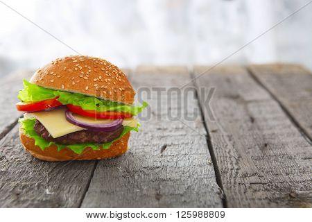 Burger Hamburger Cheeseburger On Table Wood