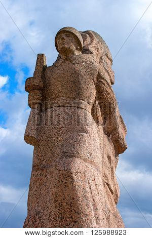 Gatchina, Russia - April 16, 2016: Memorial of the Great Patriotic War. From granite carved soldier with a gun. Close-up.