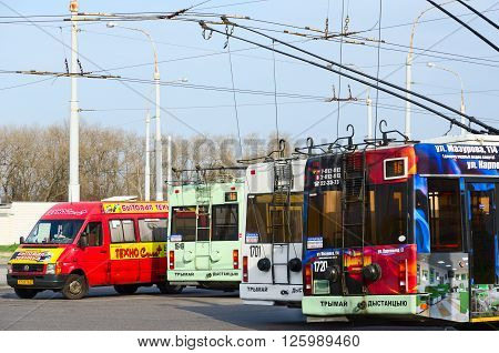 GOMEL BELARUS - APRIL 10 2016: Trolley buses and taxis at the final stop
