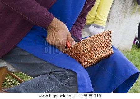 craftman at work with wicker and basket