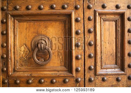 Detail of old worn timber door Florence Italy