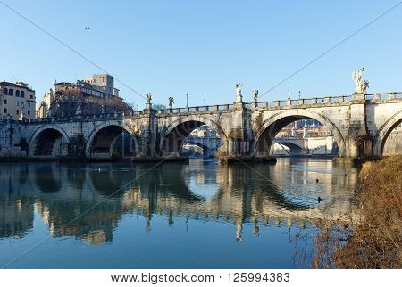 Bridge on Tiber river in Rome Italy. Morning view.** Note: Visible grain at 100%, best at smaller sizes