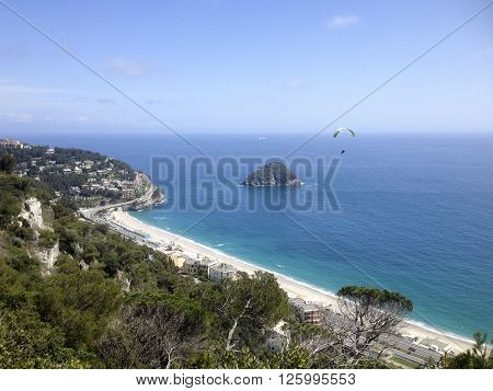 Paragliding near the isle of Bergeggi in ligurian riviera
