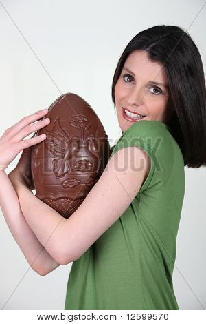 Portrait of a woman with an Easter egg