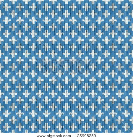 Repeating knitted seamless pattern with crosses. Woolen texture with a jacquard pattern. Abstract winter holiday design. Sweater ornament