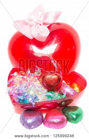 Valentine's Day chocolate gift set on white background. Heart shaped candy box.