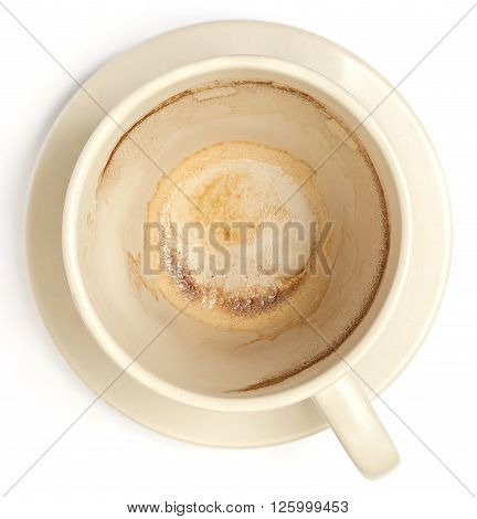 The white empty coffee cup with stained inside isolated on white background.