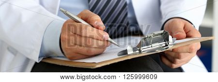 Male Medicine Doctor Hand Holding Silver Pen Writing