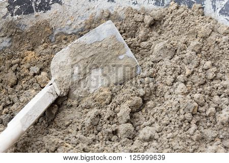 Close up mixing cement in salver for applying construction, with industrial concept, with industrial work, with industrial in house, with industrial in home, with industrial in city, with industrial object.