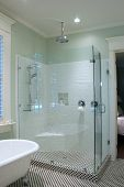 stock photo of clawfoot  - bathroom with black and white tile and glass shower - JPG