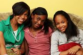 stock photo of teenage girl  - Three cute African American teenage sisters together - JPG