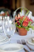 foto of flower pots  - Formal table arrangement with a floral centerpiece - JPG