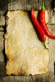 stock photo of chili peppers  - Red Hot Chili Peppers on the Old Paper sheet - JPG