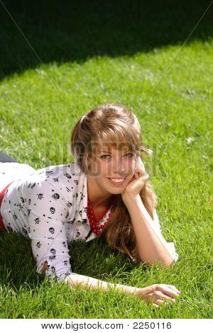 Pretty Teen Girl Lying In Grass