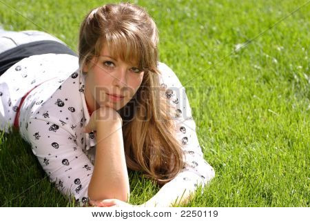 Serious Teenage Girl In The Grass