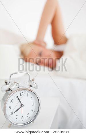 Alarmclock Waking Up A Woman