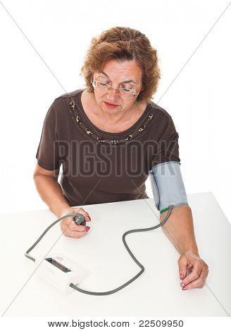 senior woman check her blodd pressure with machine