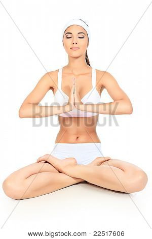 Shot of a sporty young woman doing yoga exercise. Isolated over white background.