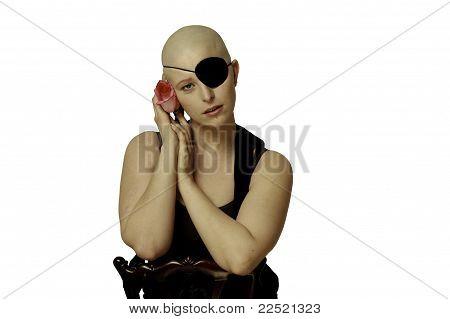 Bald girl with eyepatch