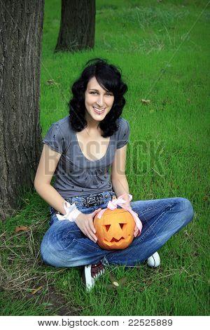 Happy Teen With Pumpkin