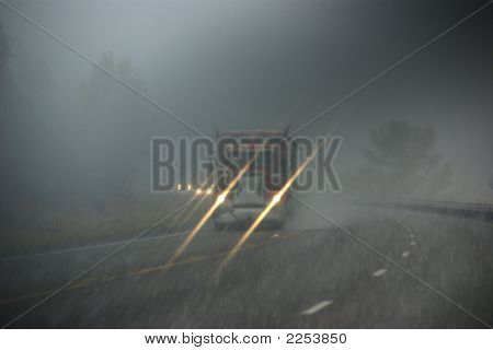 Trucks Moving Through Fog And Snowstorm