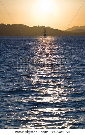 Sailboat Bathed In Dawn Sunlight
