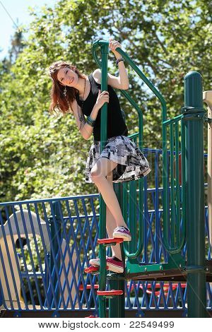 Young Teen Caucasian Girl Climbing Playground Equipment
