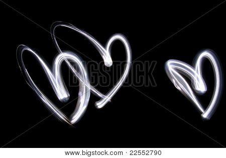 Triplet Of Lightbrushed Hearts Against Black