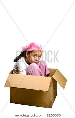 Young Girl Appearing Sad Sitting In A Box