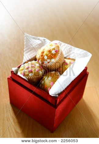 A Box Full Of Mini Star Fairycakes As Individual Birthday Cakes To Be Shared, Three Candles In The B