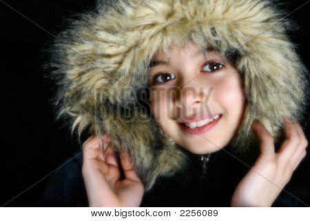 Young Girl With Furry Hooded Winter Coat On Black