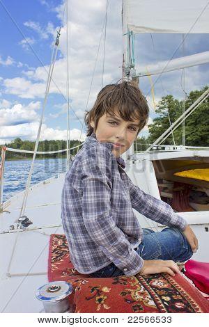boy sailng on yacht