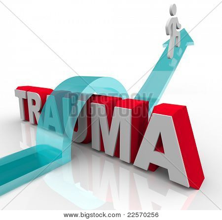 A person jumps over the word Trauma on an arrow, symbolizing the positive effects of therapy and rehabilitation as well as a good attitude