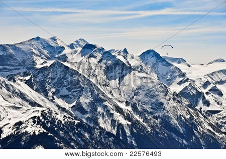 Winter mountains with parachutist