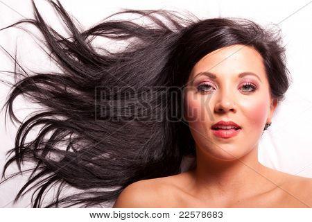 Beautiful brunette girl with long hair relaxing