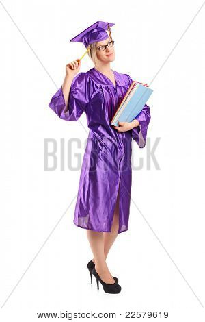 Full length portrait of a graduate student in thoughts holding a book isolated on white background