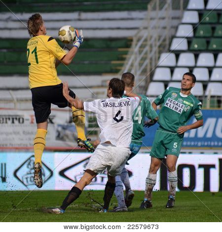 KAPOSVAR, HUNGARY - JULY 30: Lubos Hajduch (in yellow) in action at a Hungarian National Championship soccer game - Kaposvar (green) vs Videoton (white) on July 30, 2011 in Kaposvar, Hungary.