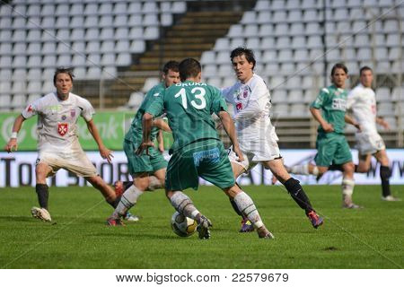 KAPOSVAR, HUNGARY - JULY 30: Drazen Okuka (in green 13) in action at a Hungarian National Championship soccer game - Kaposvar (green) vs Videoton (white) on July 30, 2011 in Kaposvar, Hungary.