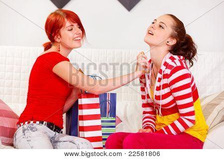 Cheerful Girl Applying New Perfume On Her Girlfriend